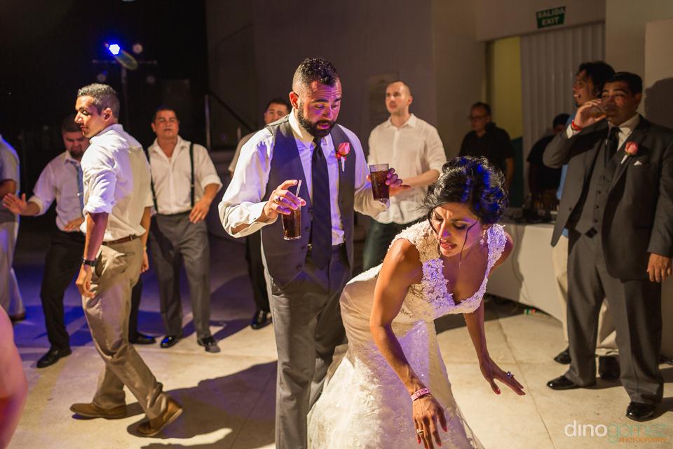 fun face of groom as bride grind dances agains him
