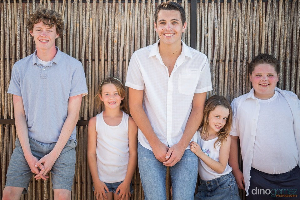 5 kids in front of a gate