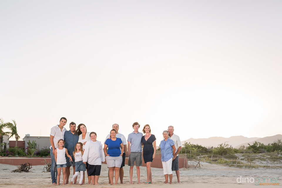 Family posing for a photo on the beach