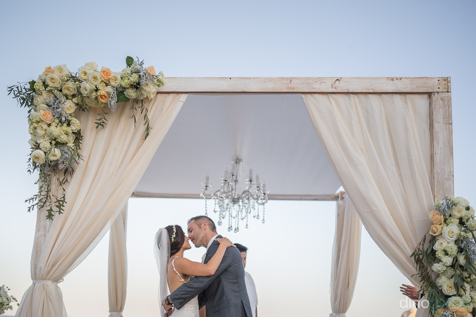 bride and groom first kiss - Monica & Parker Wedding by Photogra