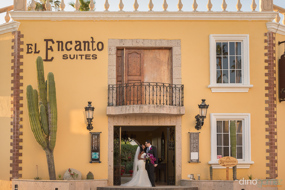 bride and groom in front of the hotel - Wedding Photographer in