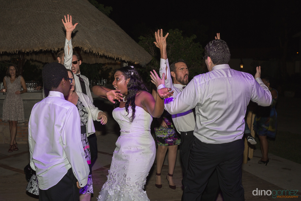 bride dancing with guests - Wedding Photographer in Mexico