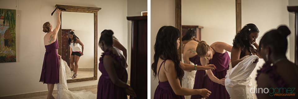 bride getting dressed by photographer in mexico