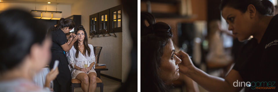 bride getting make up and hair done during getting ready