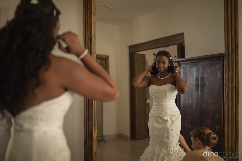 bride on mirror dress check - Wedding Photographer in Mexico