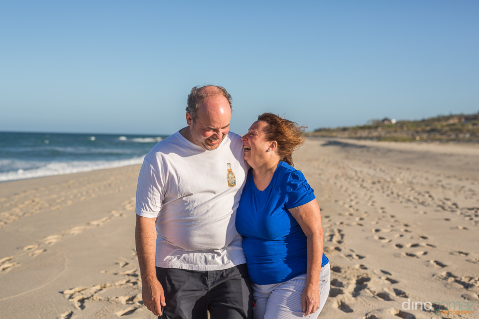 couple laughing out loud on the beach