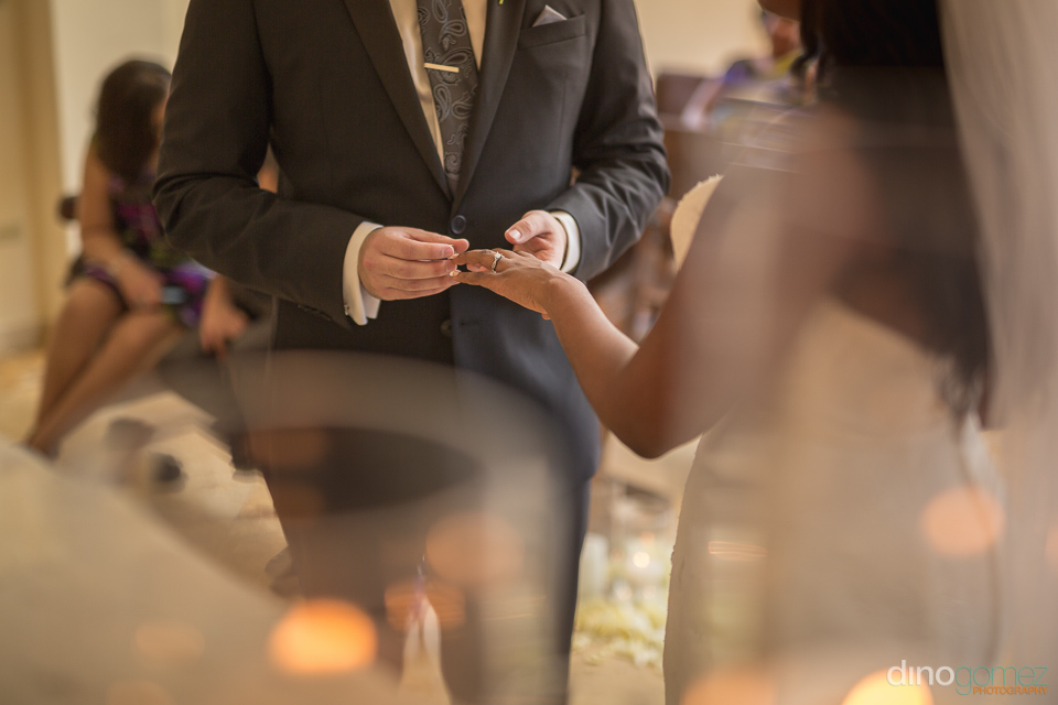 groom placing the ring - Wedding Photographer in Mexico
