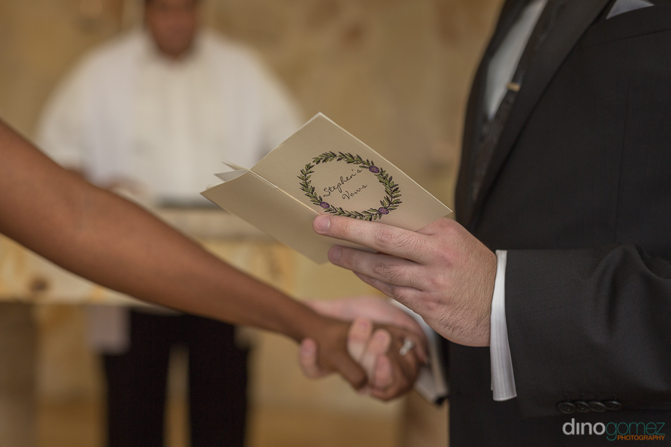 groom reading his vows - Wedding Photographer in Mexico