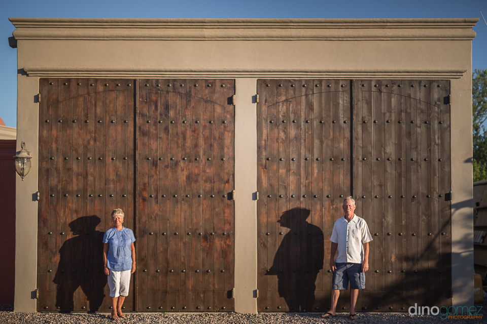 photo of two people in front of wooden doors