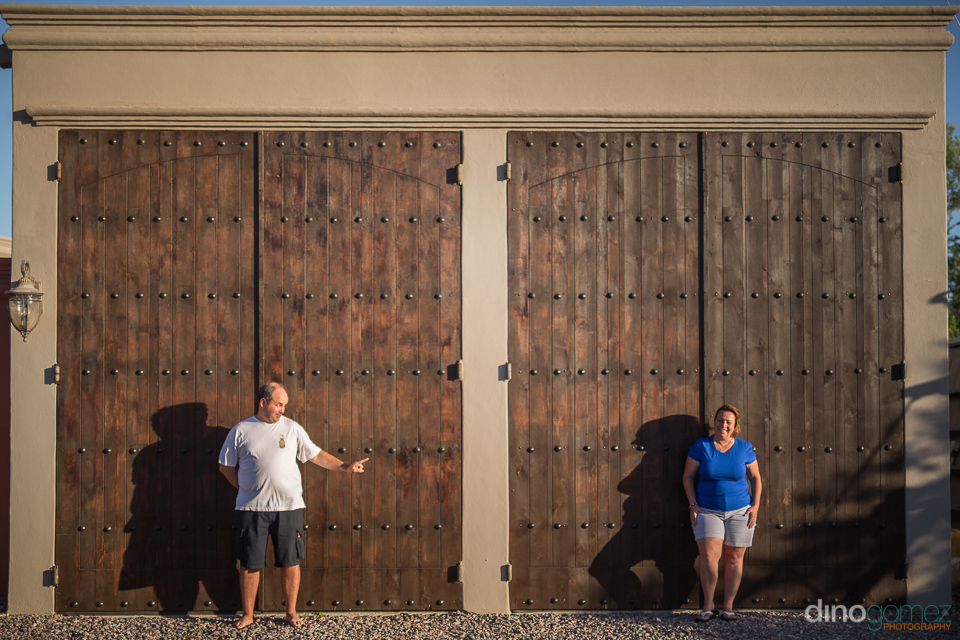 two people in front of a wooden door
