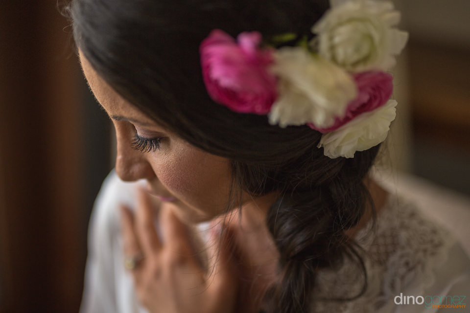 Bride with flowers on her hair - Cabo Wedding Photographers Image