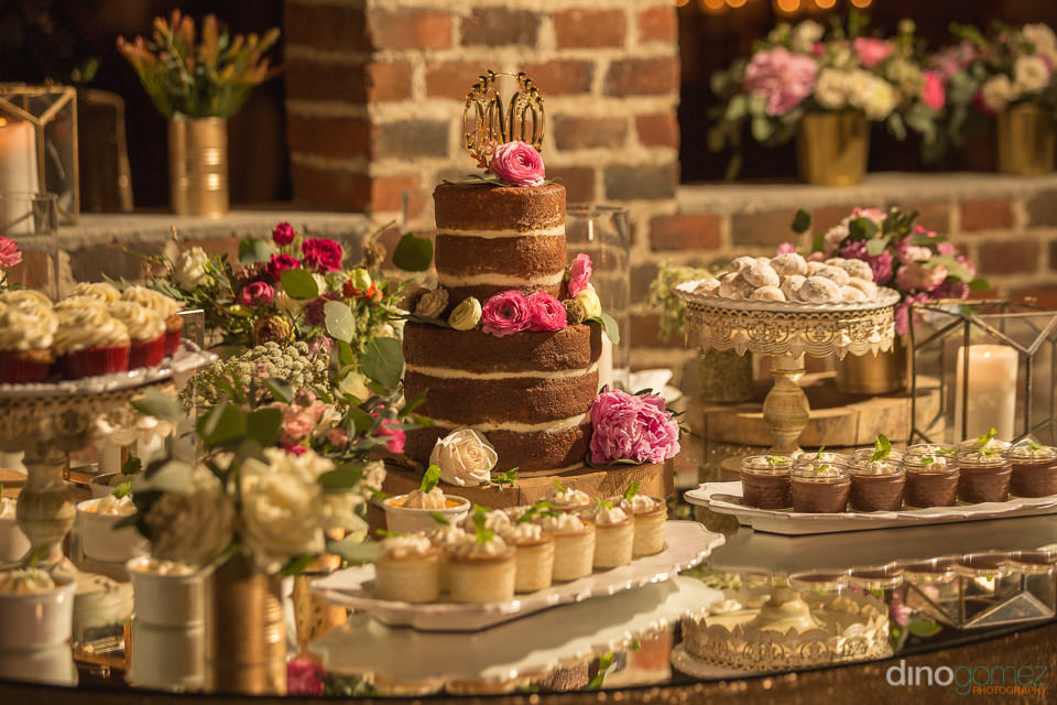 Gorgeous sweet table with wedding cake at Flora Farm
