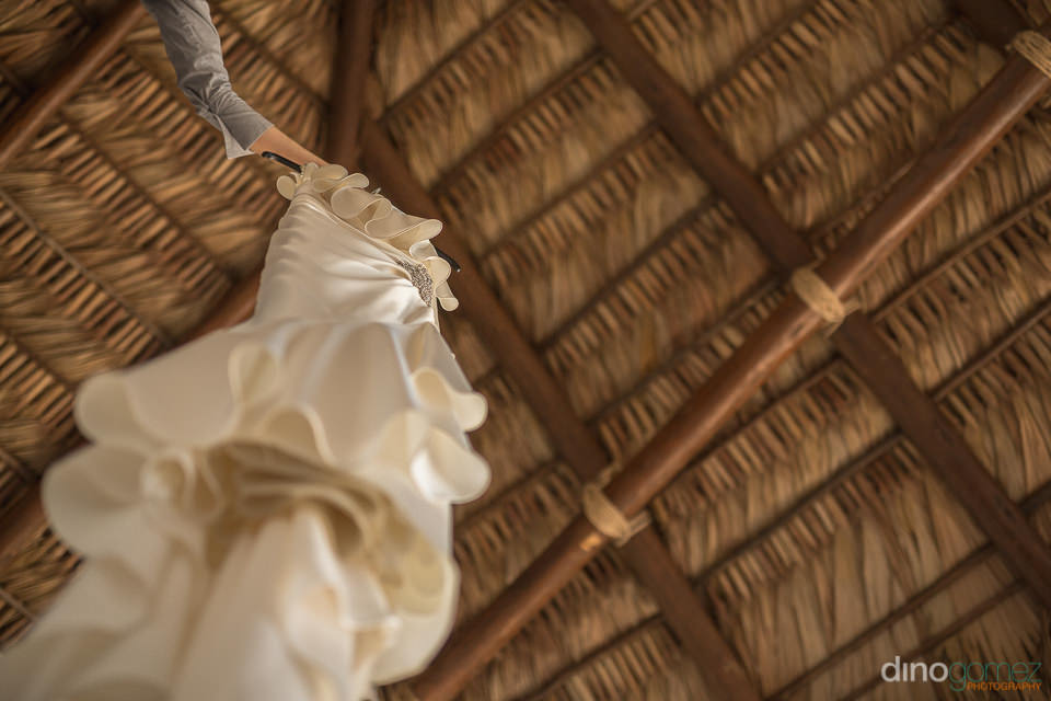 Hanging wedding dress image  - Wedding Photographer in Cabo