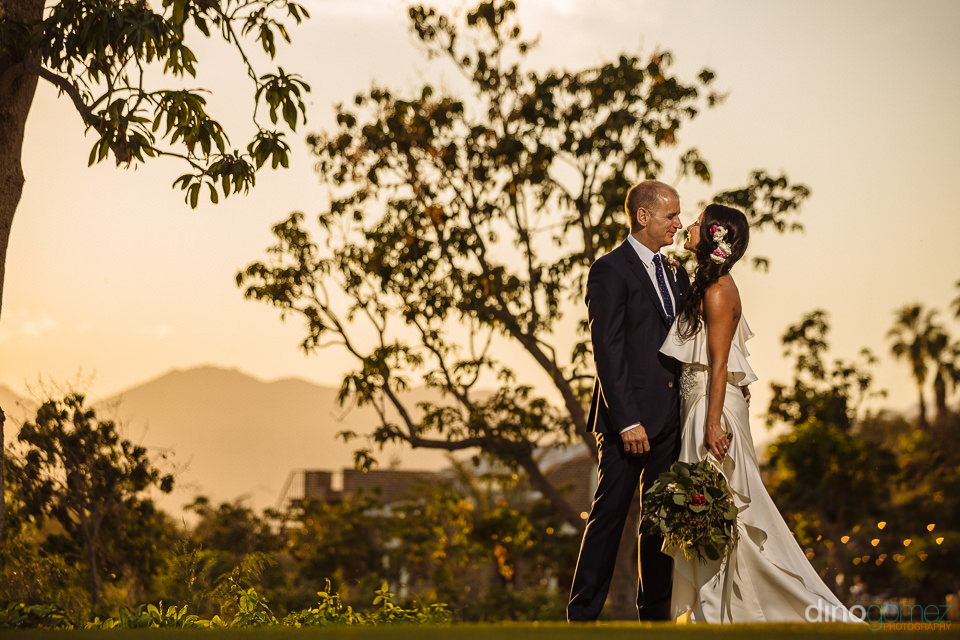 Newlywed sunset photograph at Flora Farm Los Cabos