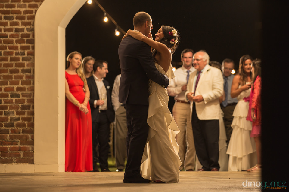 Romantic photo of the bride and groom first dance at Flora Farm