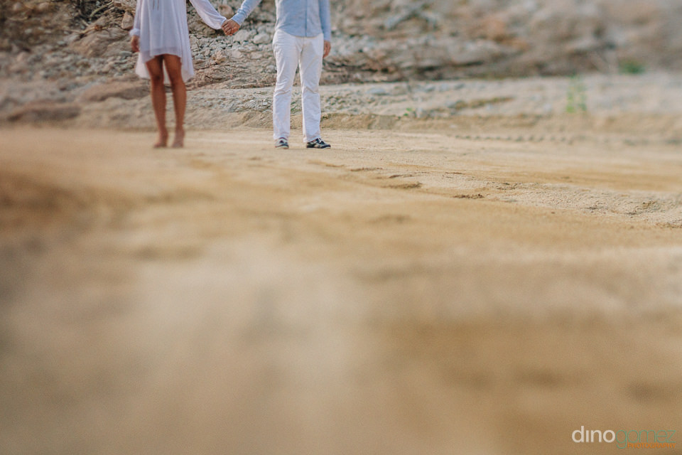 dirt road with a couple in the back for their engagement session