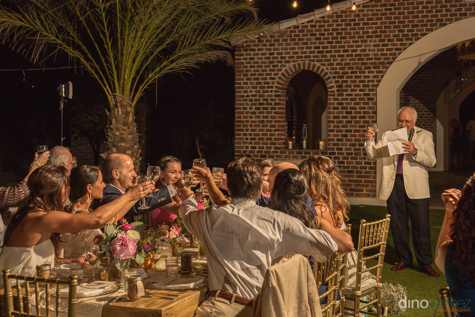 toast at wedding reception by cabo photographer Dino Gomez