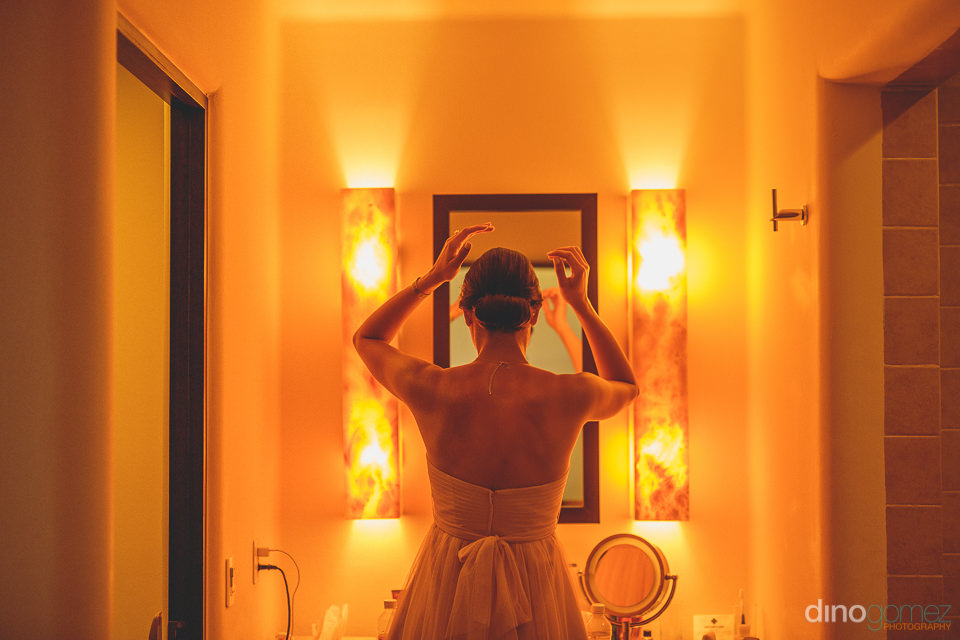 Bridesmaid does her hair before Cabo wedding