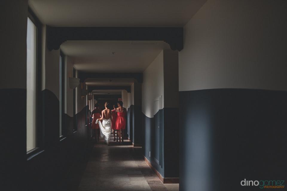 Long hallway wedding photo by Dino Gomez