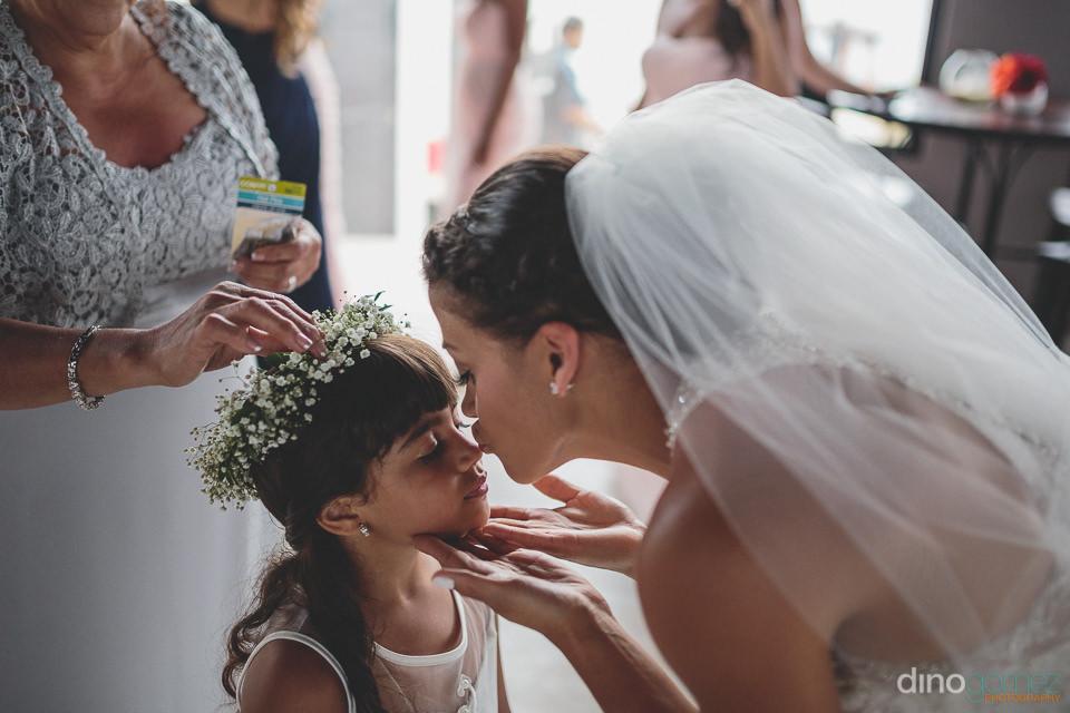 Bride kisses flower girl