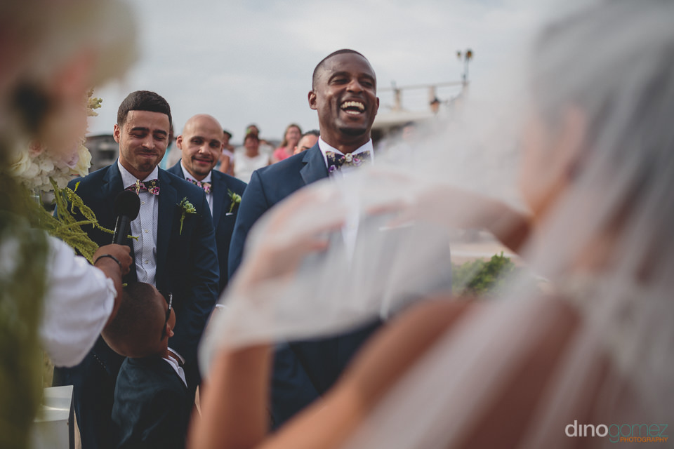 Groom smiles upon seeing his bride