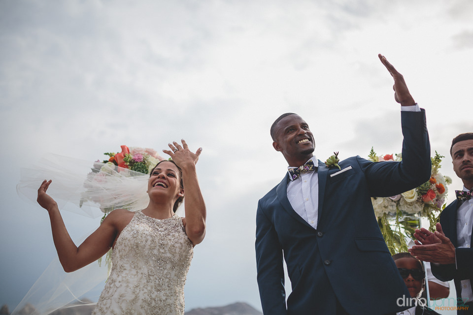 Newlyweds hold up their rings at destination Mexico wedding