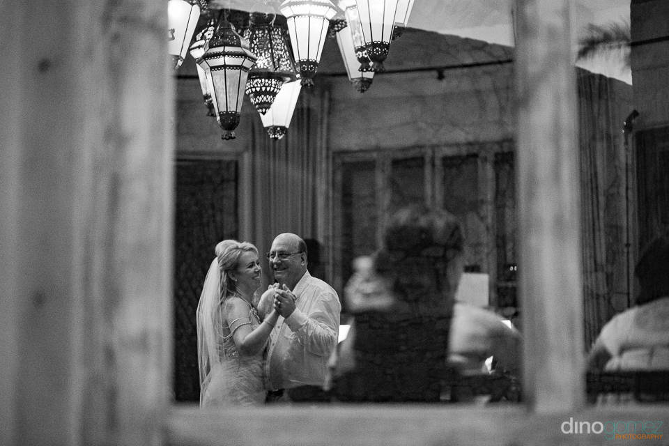 black and white photo bride dancing with father
