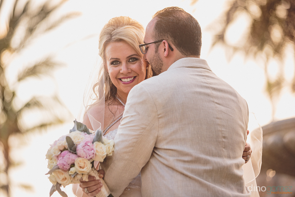 bride smiles after cabo wedding