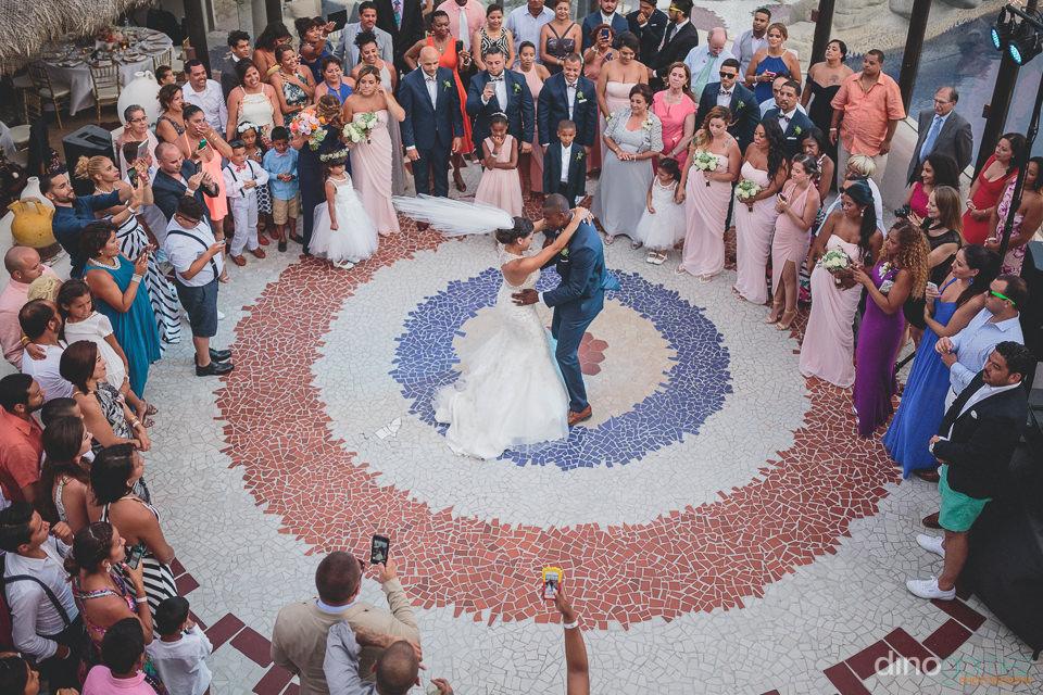 Bride and groom center of the dance floor