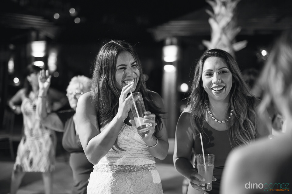 Bride and friends smile at Cabo wedding