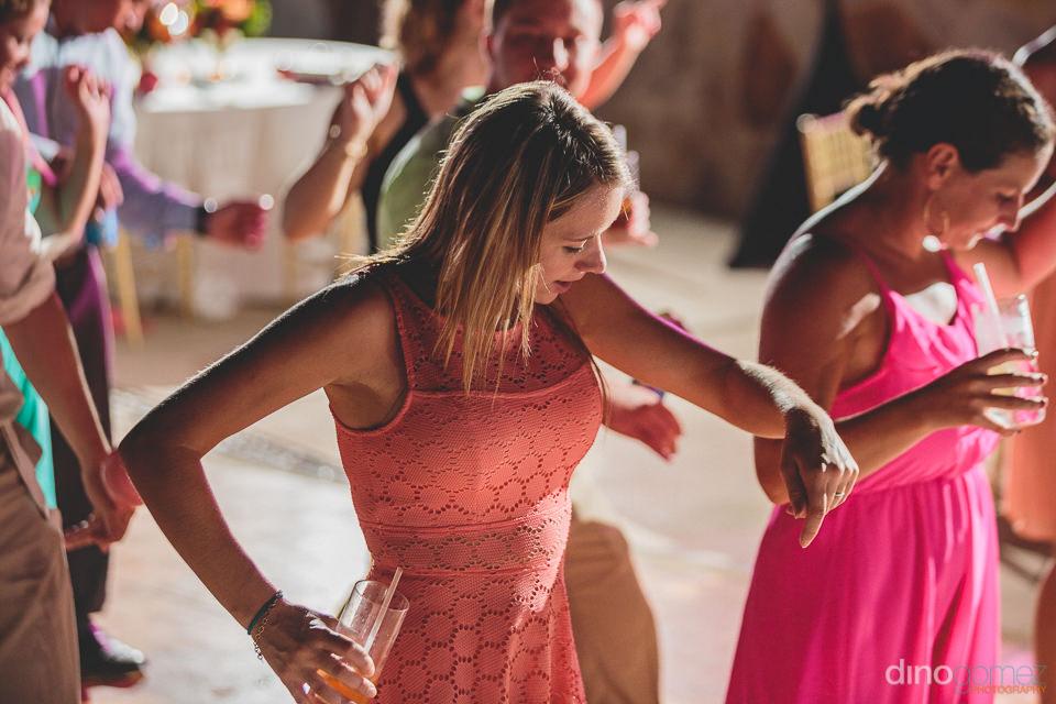 Dino gomez photo of wedding guests dancing