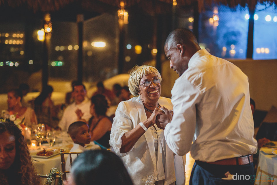 Mother congratulates son on wedding day