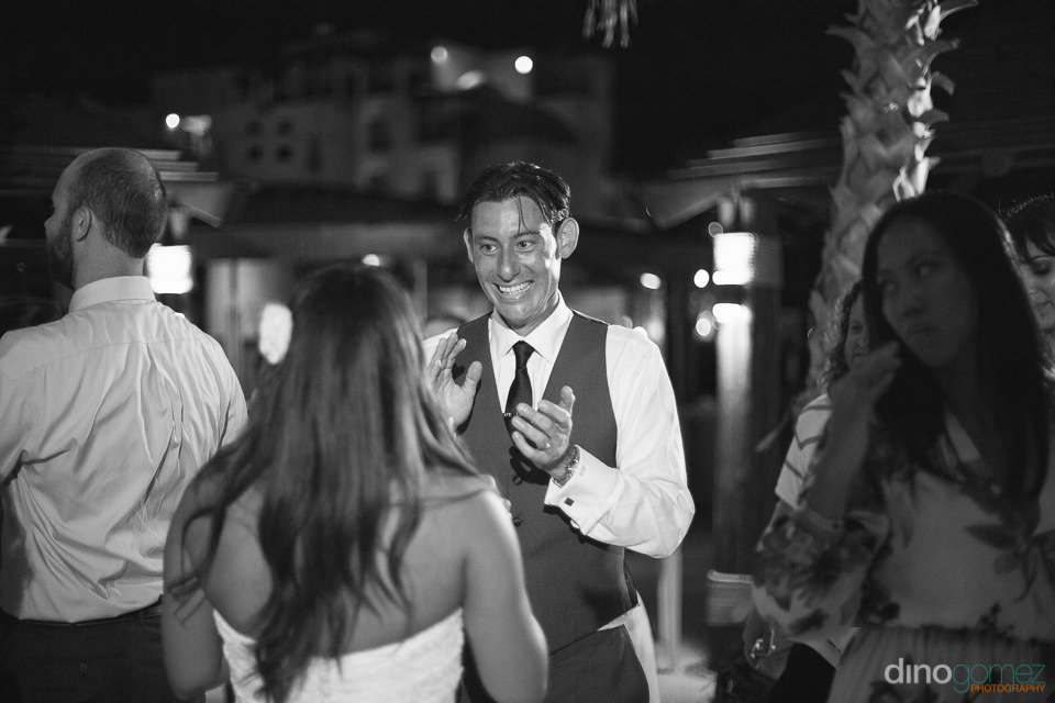 Groom smiling at Cabo event wedding