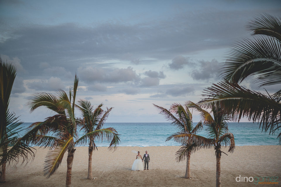 breathtaking cabo beach wedding photo by dino gomez