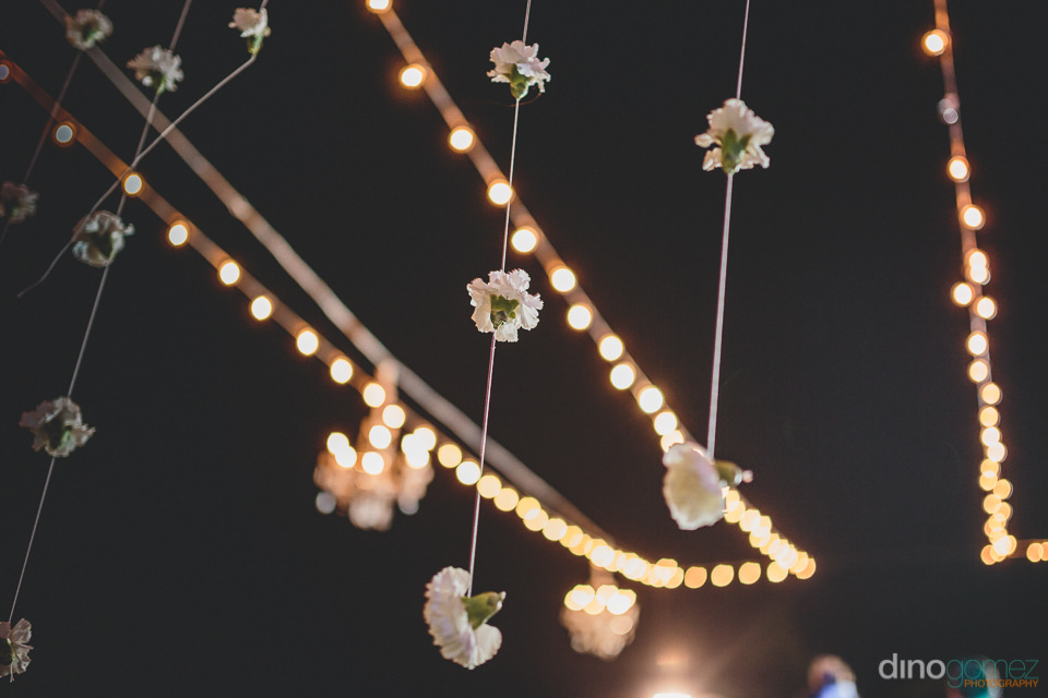 unique floral lighting at cabo wedding photo by dino gomez