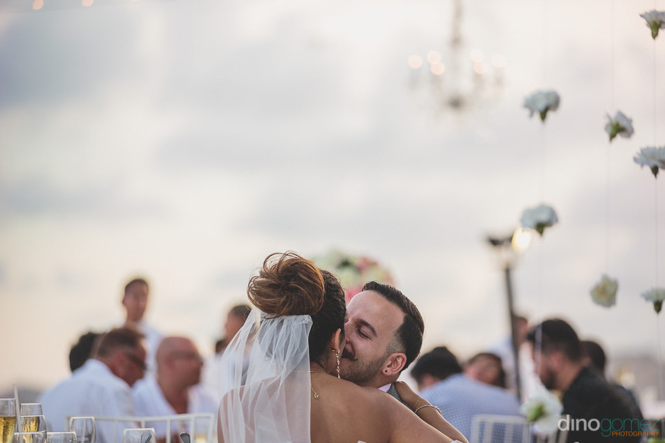 wedding couple kiss during dinner