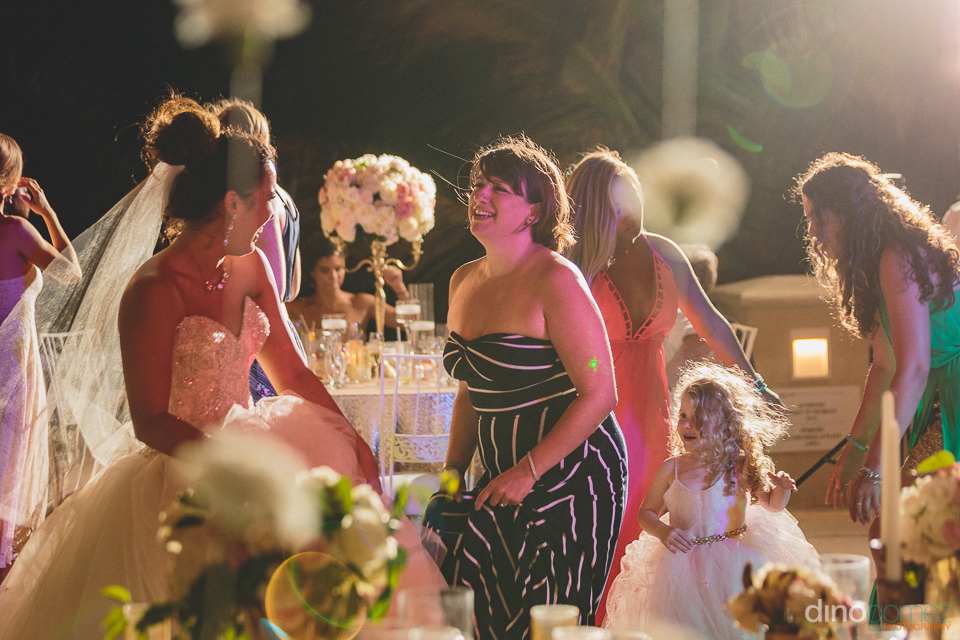 bride entertains guests in cabo san lucas