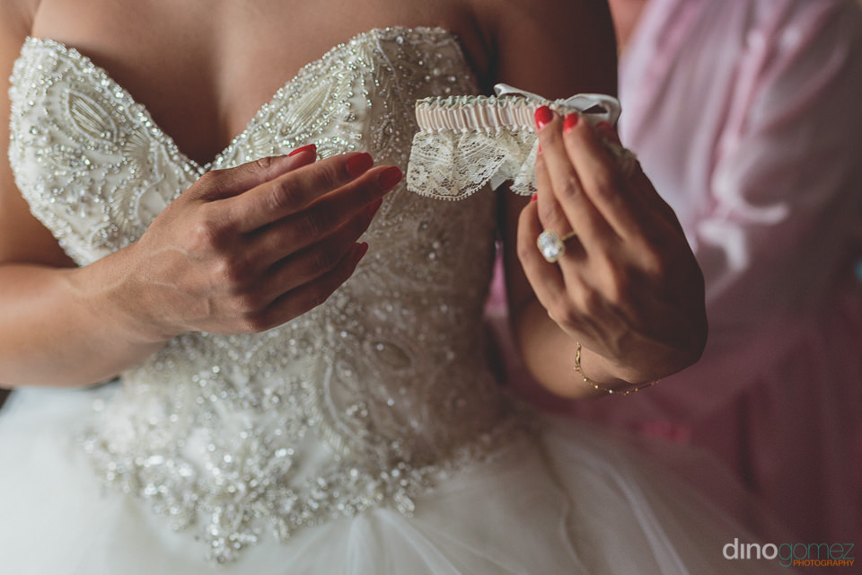 white wedding dress and sparkling wedding ring