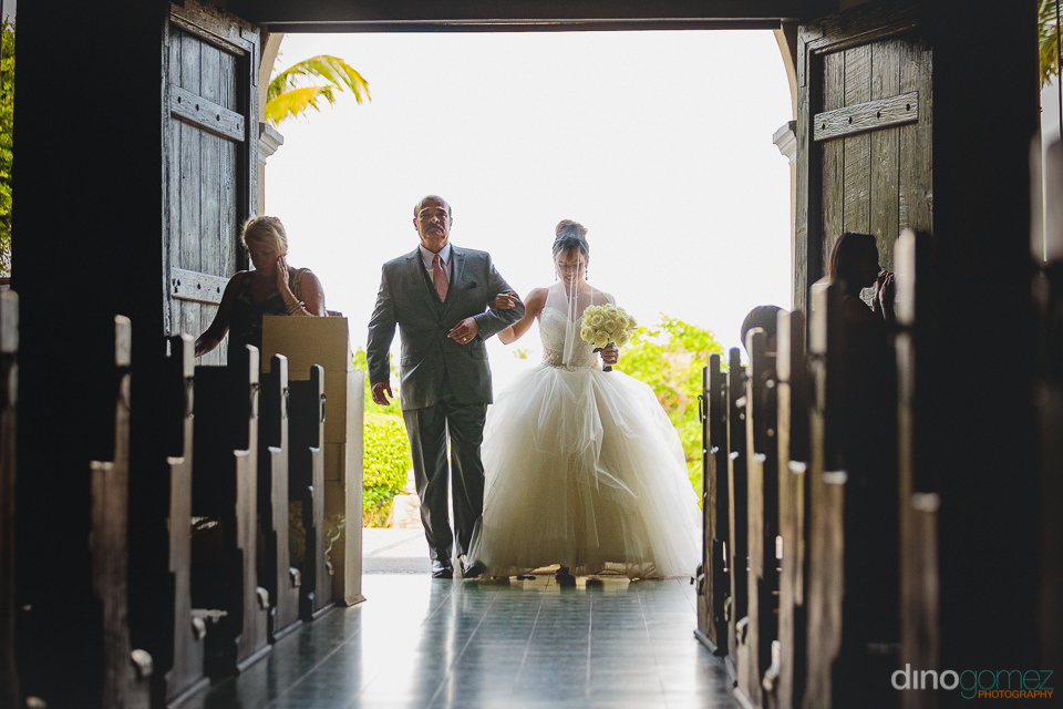 bride enters the cabo church for her wedding