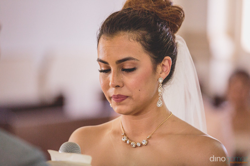 bride cries while she says her vows