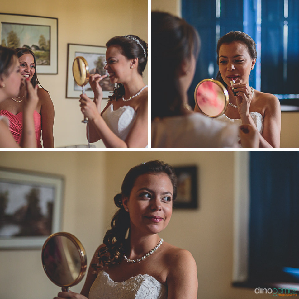 bride puts on lipstick and makeup before backyard wedding
