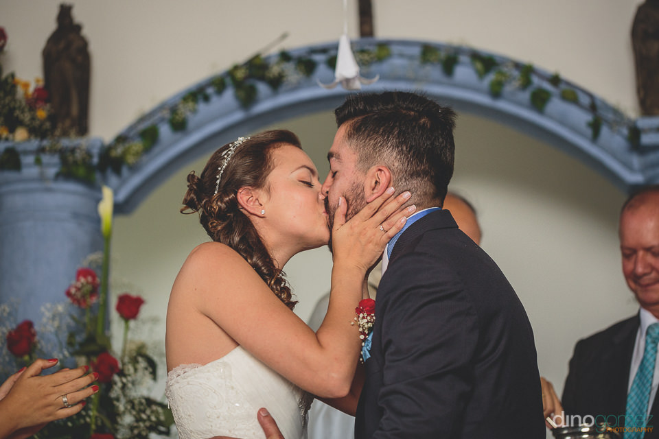south american newlyweds kiss after saying i do