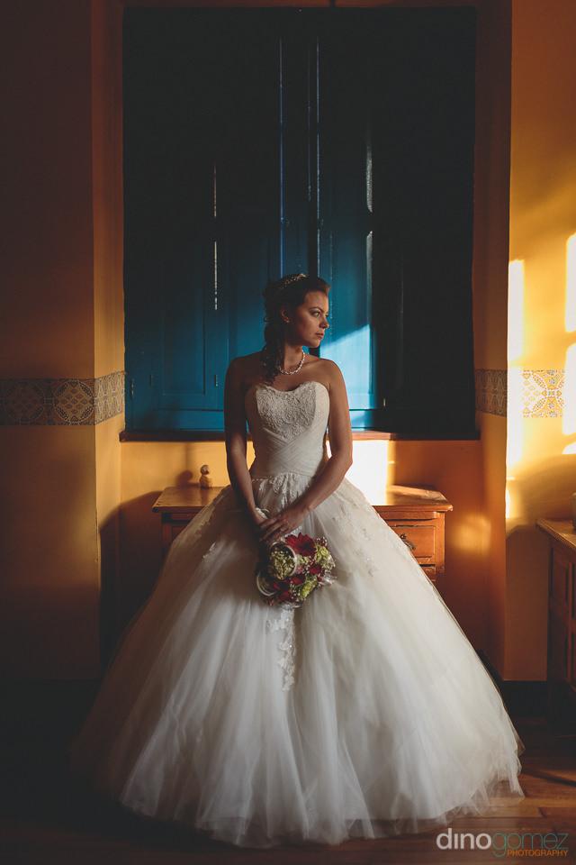 dino gomez photo of colombian bride at outdoor wedding