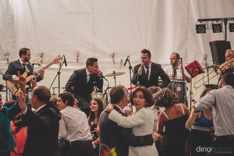 wedding guests dance at backyard wedding