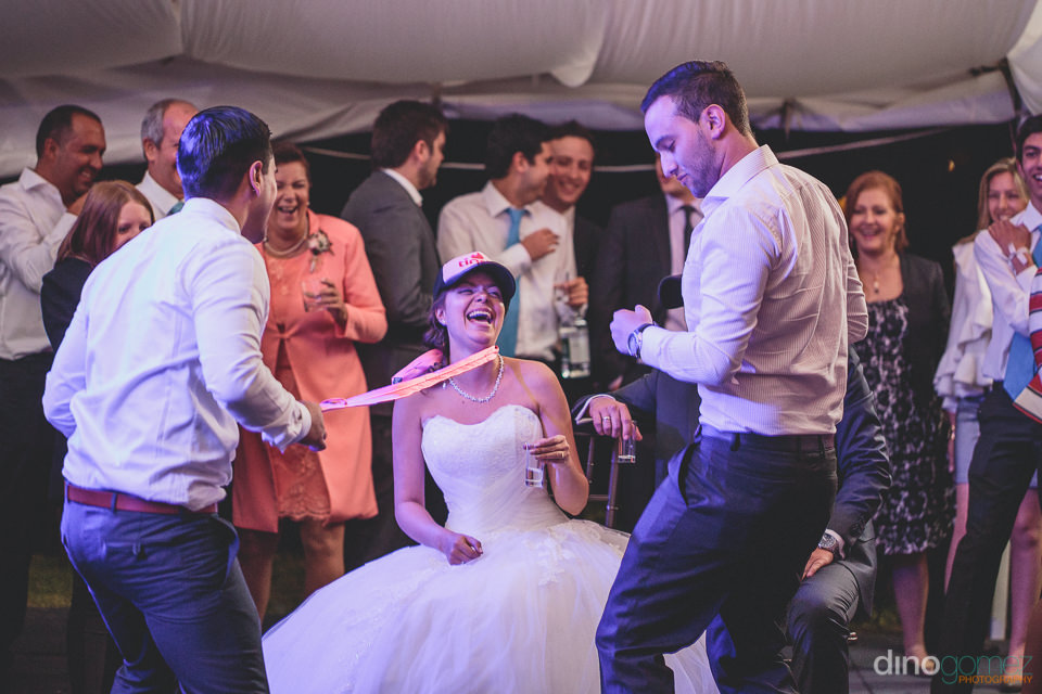 wedding guests entertain bride and groom at south american weddi