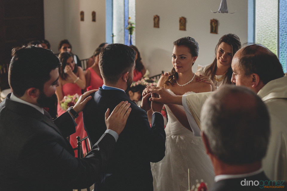 bride and groom stand at the altar during their colombian church