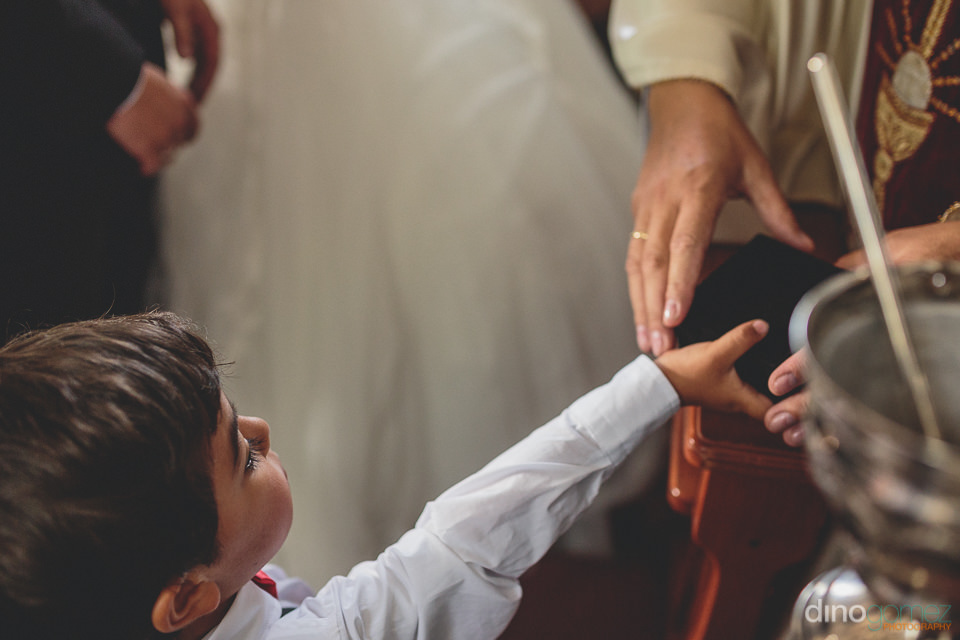 young ring bearer presents the rings at south american wedding â