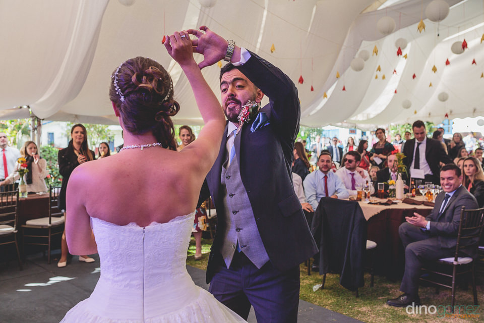 bogota photographer dino gomez photo of newlyweds dancing at wed