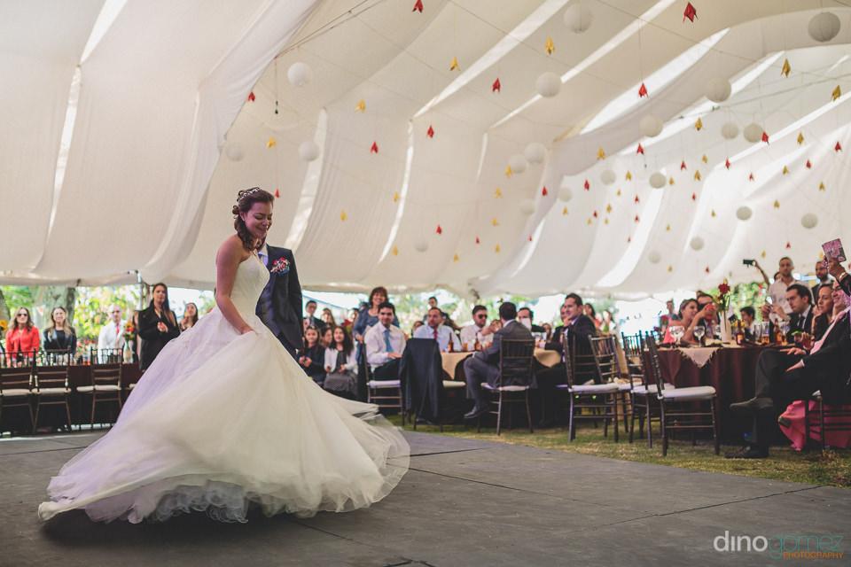 bride dancing in wedding dress at hacienda wedding reception