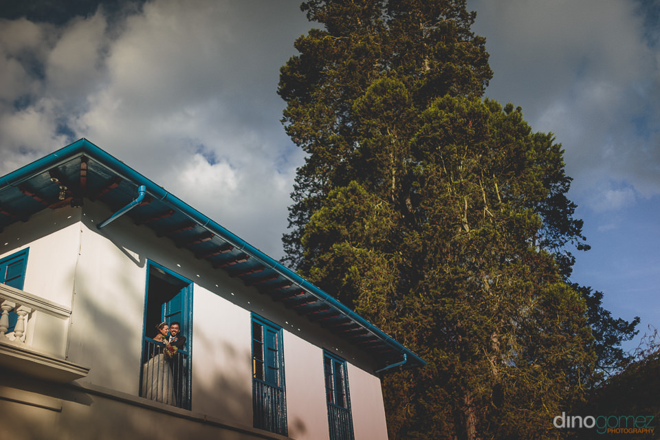 blue and white colombian hacienda matches the cloudy sky – din